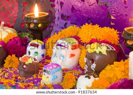 Mexican Day of the dead altar created entirely for this image session. Carefully arranged all the pieces, candles and flowers. - stock photo