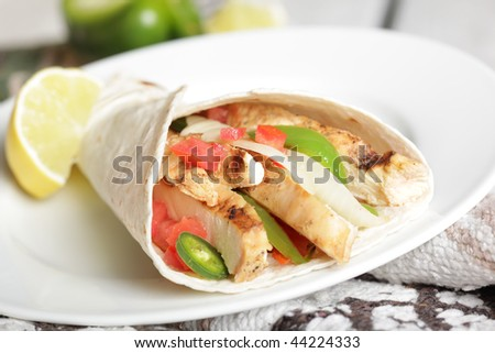 Mexican fajitas burrito - stock photo