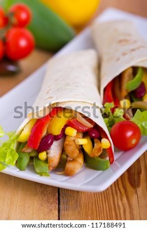 Mexican fajitas (tortilla wrap) - stock photo