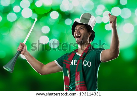 Mexican Fan Celebrating, on a green lights background. - stock photo