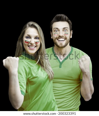 Mexican fans couple celebrate on black background