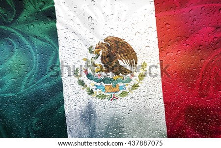 Mexican flag with watter drops, rainy weather, Mexico - stock photo