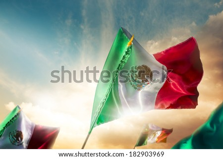 Mexican Flags with dramatic lighting, Independence day, cinco de mayo celebration - stock photo