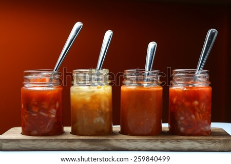 Mexican food dips and sauces in bottles Photo of different Mexican food dips and sauces in bottles - stock photo