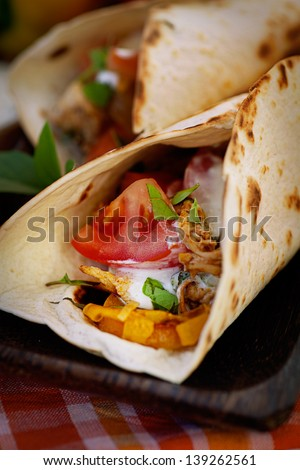 Mexican food. Fresh tortilla fajita wraps with chicken and vegetables - stock photo