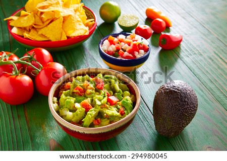 Mexican food nachos guacamole pico de gallo and chili peppers sauces - stock photo