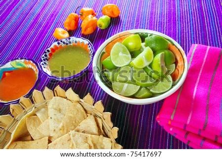 Mexican food varied chili sauces nachos lemon Mexico flavor - stock photo