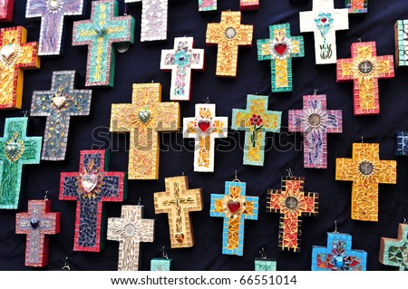 Mexican handcrafted christian crosses for sale at the art market in San Angel, Mexico City. - stock photo