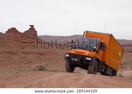 MEXICAN HAT, UTAH, USA - April 25: Custom Expedition Vehicle RV driving on dirt road in the Valley of Gods, Utah on April 25, 2014.
