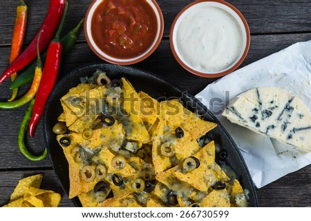 mexican hot street food nachos with salsa dip from above - stock photo