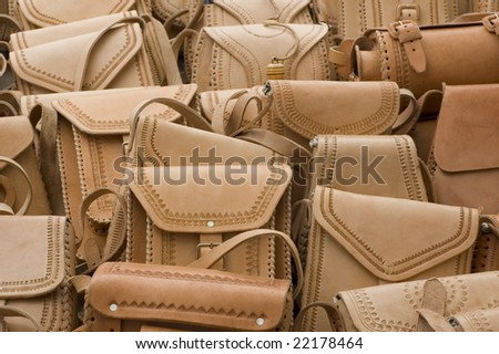 Mexican leather handbags for sale at an outdoor market in Chiapas, Mexico