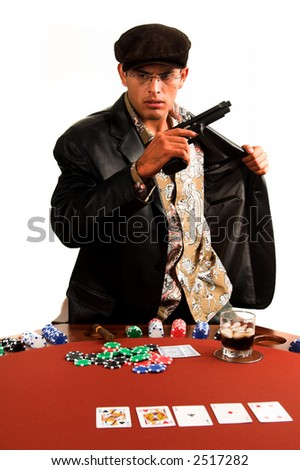 Mexican man playing Texas Hold um Poker stands up and draws a pistol out of his leather coat as the game goes bad - stock photo