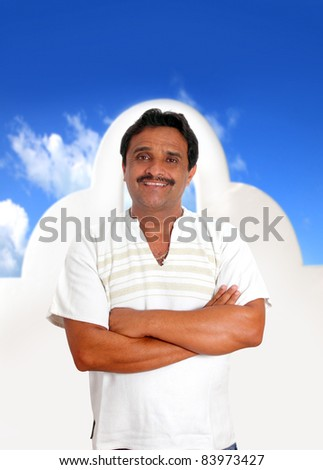 Mexican man with mayan shirt smiling in front a white Mexico house [ photo-illustration ] - stock photo