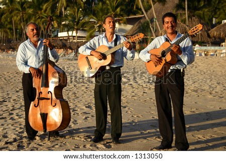 Mexican mariachi band playing on a beach - stock photo