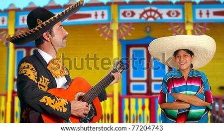 Mexican mariachi charro man and poncho Mexico girl colorful facade houses [Photo Illustration]