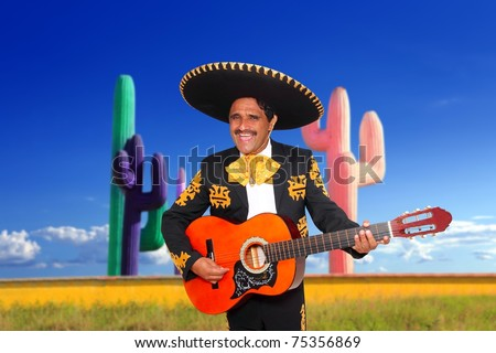 Mexican mariachi charro singing playing guitar in cactus background Mexico [Photo Illustration] - stock photo