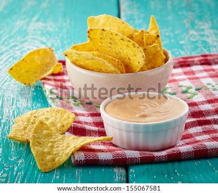 Mexican nachos and dip on blue wooden background - stock photo