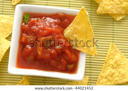 Mexican nachos and red dip - stock photo