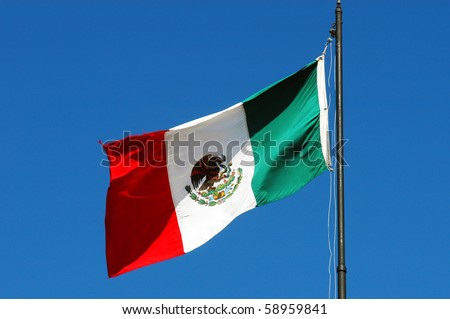 Mexican national flag waving on blue sky - stock photo