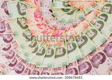 Mexican pesos, bills of 50, 100, 200, 500 - stock photo