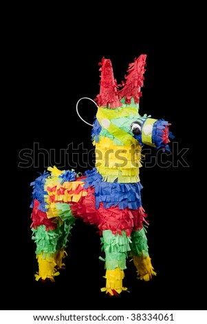 mexican pinata on a black background - stock photo