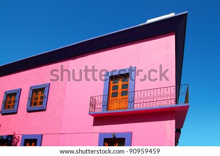 Mexican pink house facade detail wooden doors