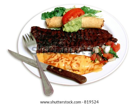Mexican Plate-grilled beef fajita skirt steak with a cheese enchilada and flauta - stock photo