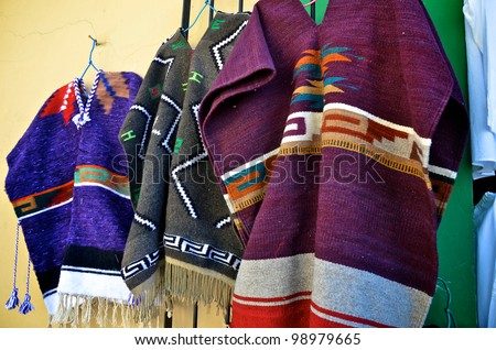 Mexican ponchos hanging for sale - stock photo