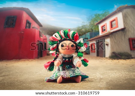Mexican rag doll in a traditional dress on a mexican village - stock photo