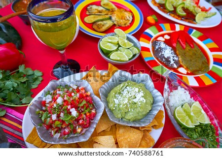 Mexican recipes mix on a colorful table with sauces from Mexico