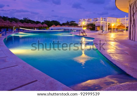 Mexican resort swimming pool at night.