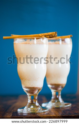 Mexican restaurant bar serving a traditional cinnamon horchata with cinnamons sticks. - stock photo