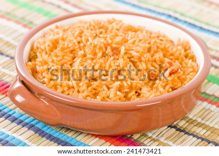 Mexican Rice - Rice cooked with tomato sauce and chicken broth. - stock photo