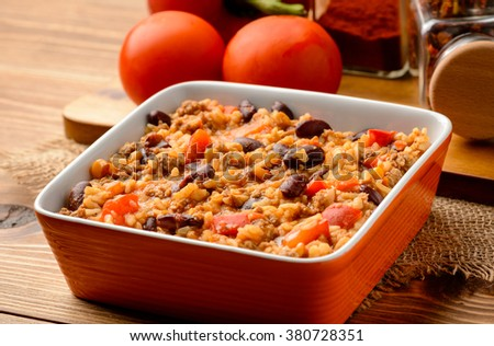 Mexican rice with black bean, corn, paprika and tomatoes.