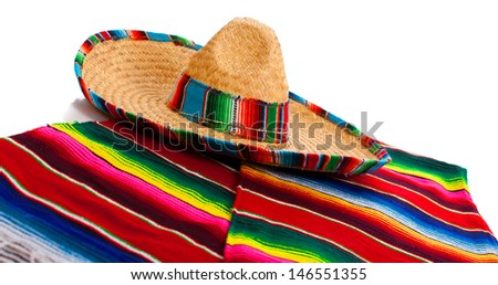 Mexican Serape and a sombrero on a white background - stock photo