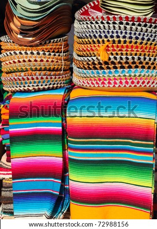 Mexican serape colorful stacked and charro hats mariachi - stock photo