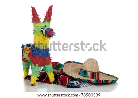 Mexican Serape, sombrero and pinata on a white background with copy space - stock photo