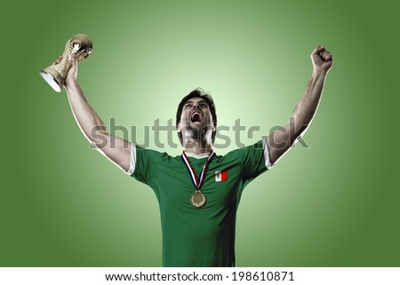 Mexican soccer player, celebrating the championship with a trophy in his hand. On a green background.