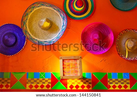 Mexican sombreros on the wall - stock photo