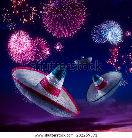 Mexican sombreros with fireworks at night - stock photo
