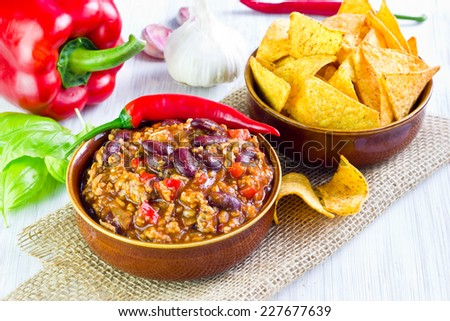 Mexican soup (like chili con carne) with tacos, selective focus  - stock photo