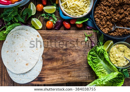 Mexican street simple street food, tortillas with minced beef and guacamole. - stock photo