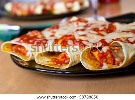 Mexican style enchiladas - stock photo