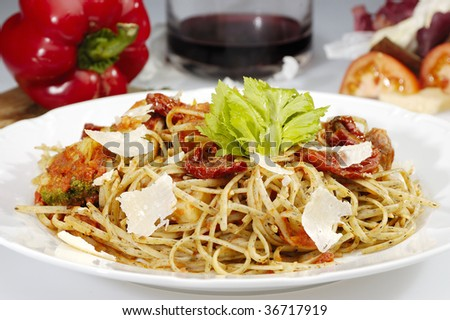 Mexican style spaghetti w dried tomatoes and parmesan