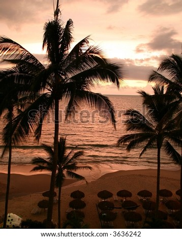 Mexican sunset on the beach - stock photo