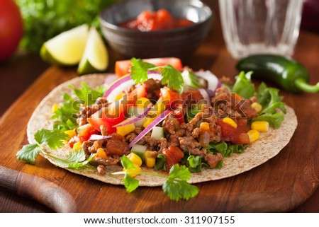 mexican taco with beef tomato salsa onion corn - stock photo