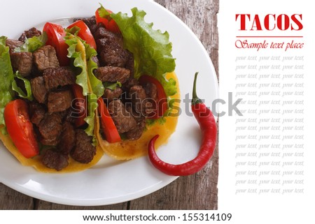 Mexican tacos with pepper chili  on a wooden table. close up - stock photo
