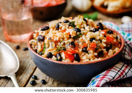 Mexican tomato black beans rice with cilantro. the toning. selective focus - stock photo