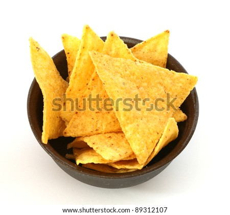 Mexican tortilla chips in brown bowl on white background - stock photo