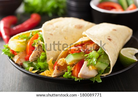 mexican tortilla wrap with chicken breast and vegetables - stock photo